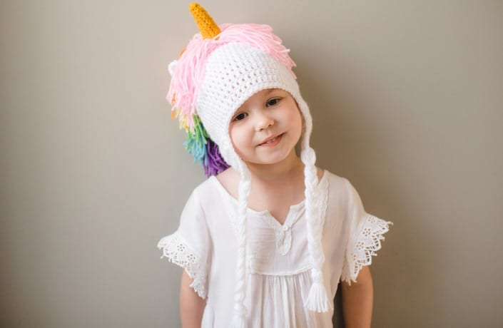 A picture of smiling young girl Wren Jansen in a crochet unicorn outfit