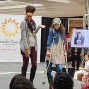 NPCF Fashion Funds the Cure Mall Runway Show with two models