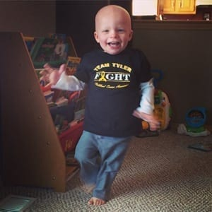 Picture of Tyler Kaspari smiling and running around with tshirt Team Tyler Fight