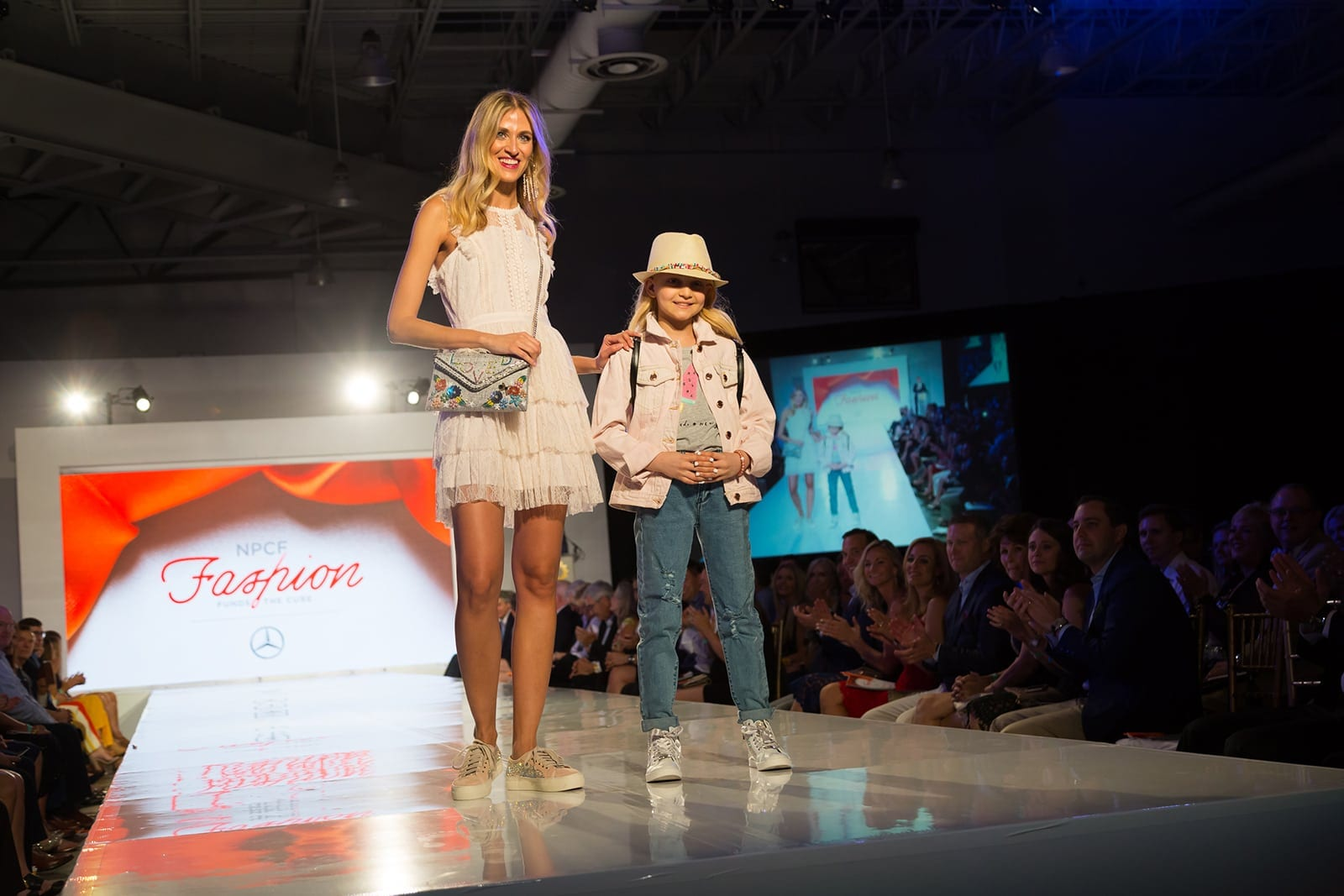 Tampa Fashion model with Pediatric Cancer Patient walking down runway