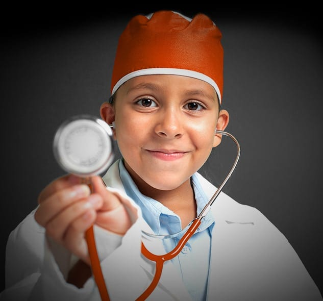 Young Child Smiling in Orange Doctor Surgical Cap and Stethoscope